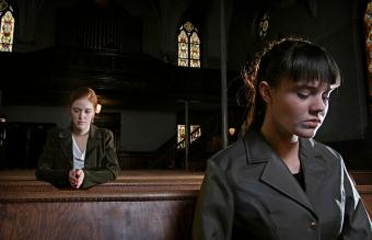 Women praying in an old church