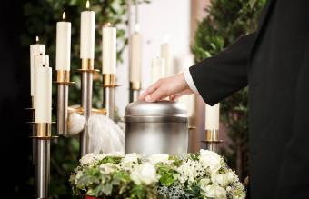 person on funeral with urn