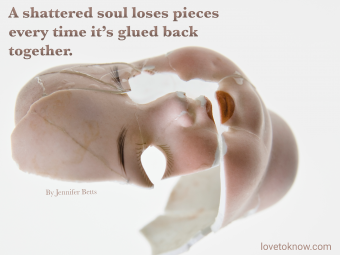 Broken doll with a suicide awareness quote