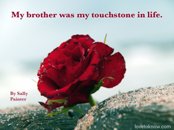 Rose and stones in a beach and quote about death of a brother