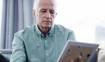 Sad man looking at a photo