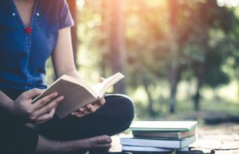 Woman reading near death experience book