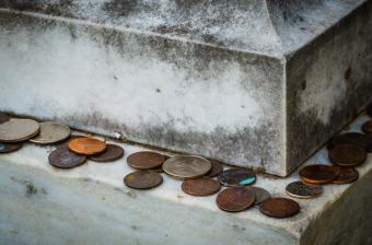 Coins left on a tombstone