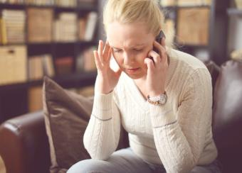 Sad woman on phone call