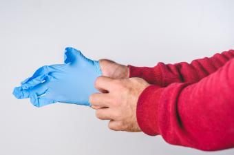 Man putting on medical gloves