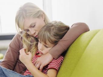 Mom comforting child