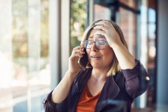 Woman looking distraught while talking on a mobile phone