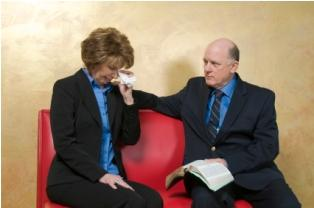 Man holding Bible comforts grieving woman