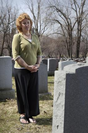 Woman visiting a grave; copyright Imageegami at Dreamstime.com