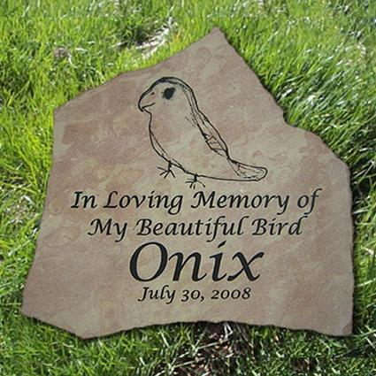 Flagstone pet bird grave marker with inscription