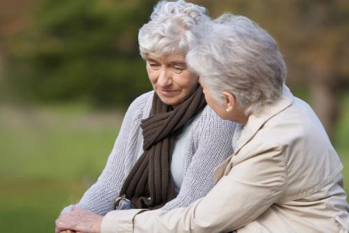 senior woman caring for her friend