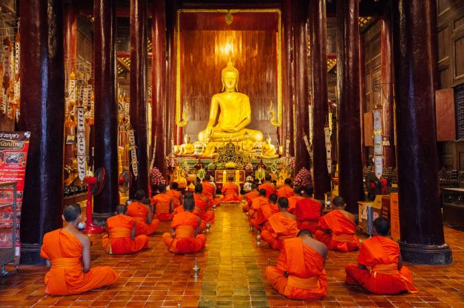 Buddhist monks meditating in temple