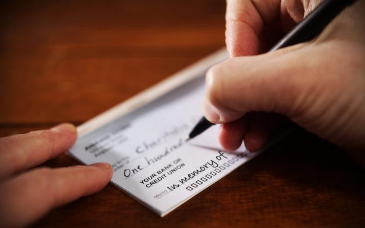 Writing a check to charity