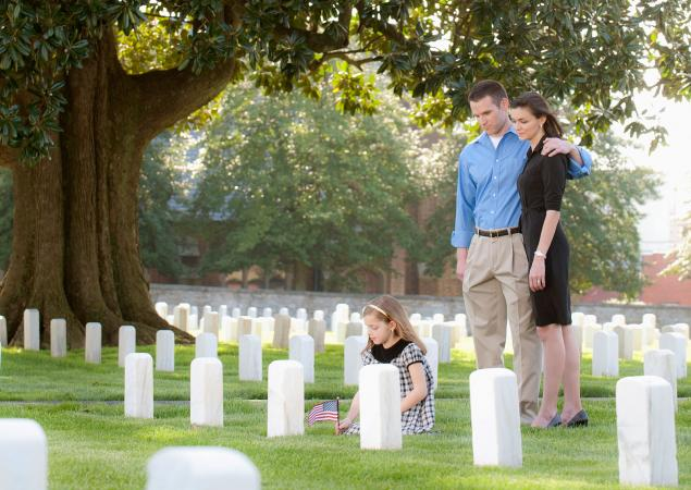 Honoring soldier's grave in cemetery