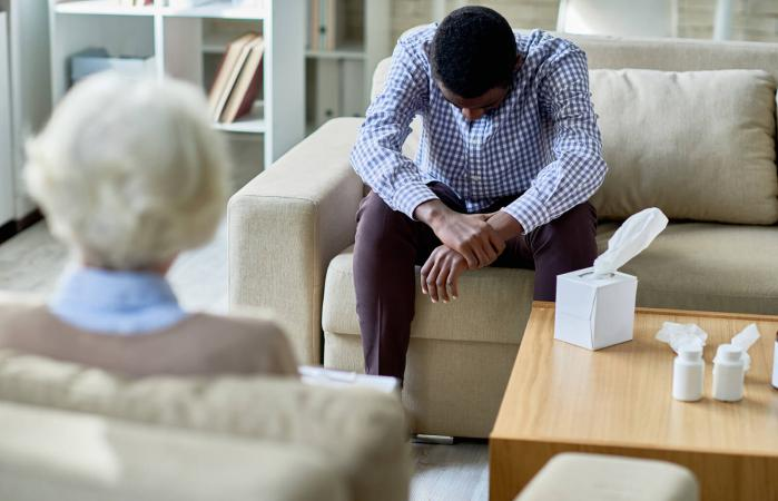 Man receiving Christian grief counseling