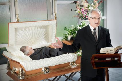 Man delivering a funeral message