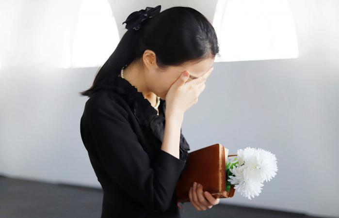 Woman Crying at a Funeral
