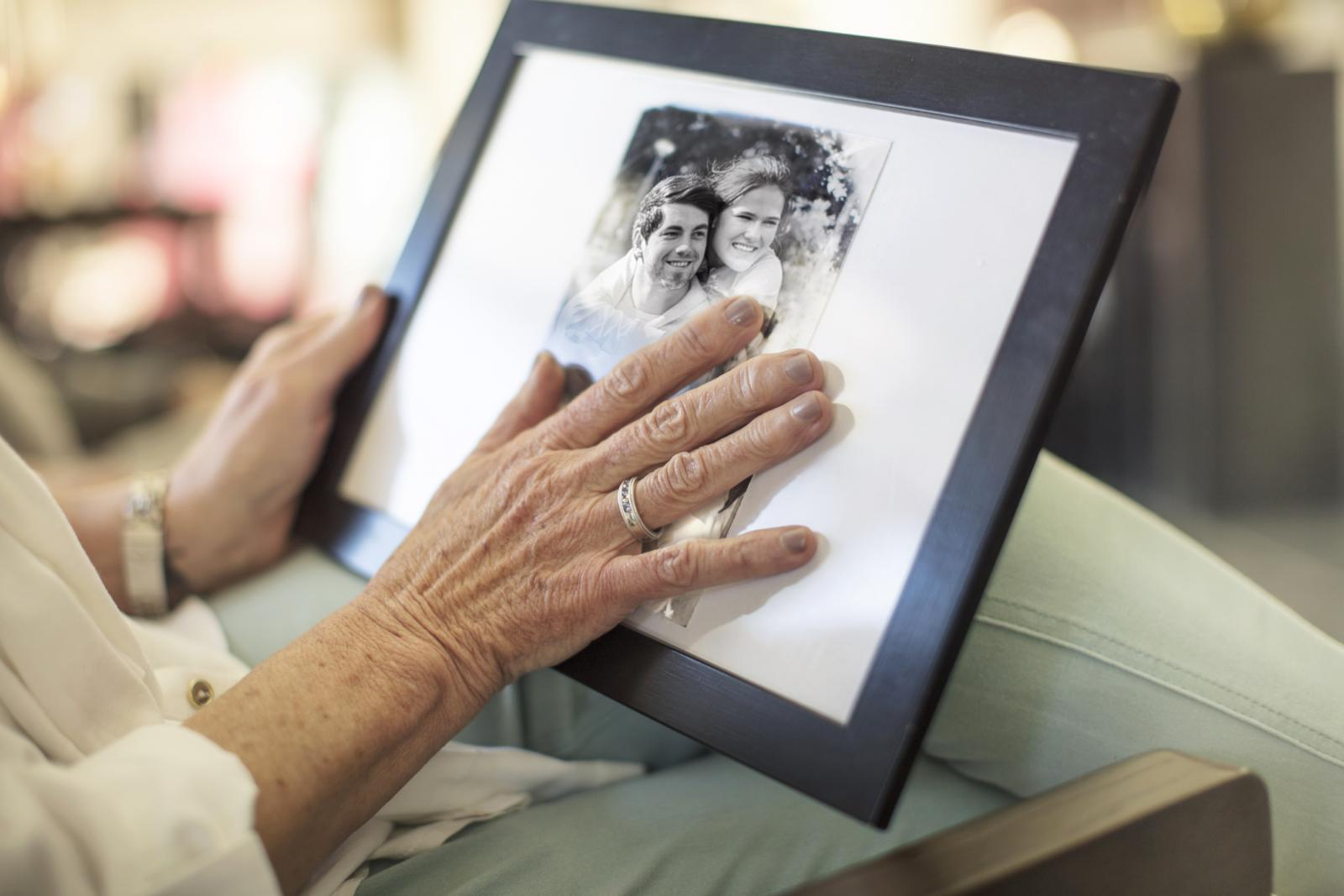 Senior woman holding a photograph