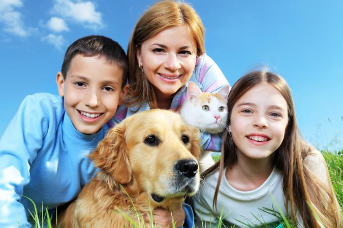 Family with pet cat and dog