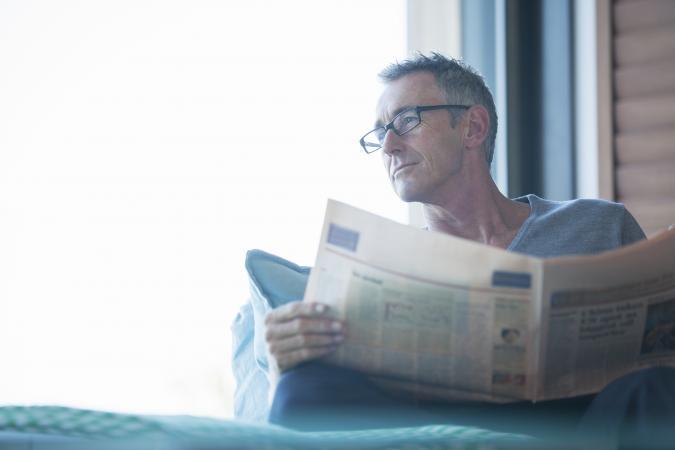 Man-reading-paper.jpg