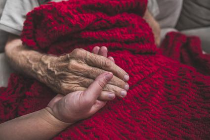 Young hand holding a senior's hand