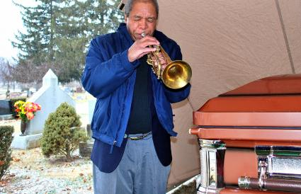Jazz trumpet player performing at funeral