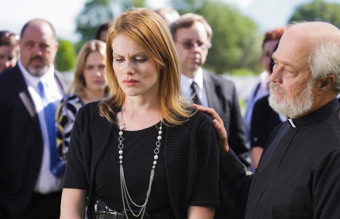 Grieving woman at a funeral