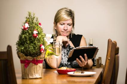 A middle-aged woman at home by her self at Christmas