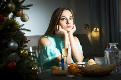 Sad woman celebrating Christmas