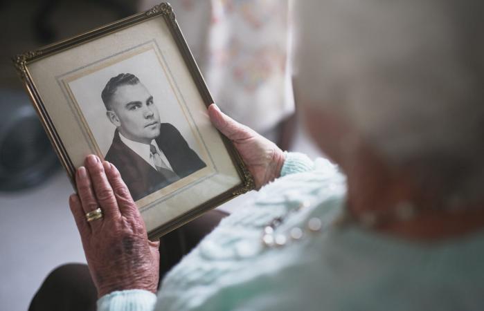 senior woman looking at an old photo