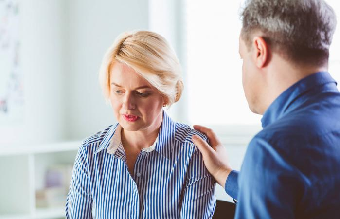 Depressed woman discussing with therapist