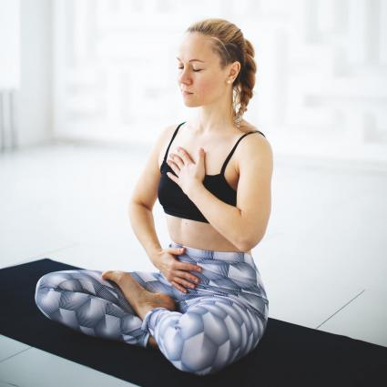 Woman doing breathing exercises