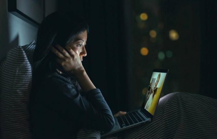 woman in deep thought while using laptop