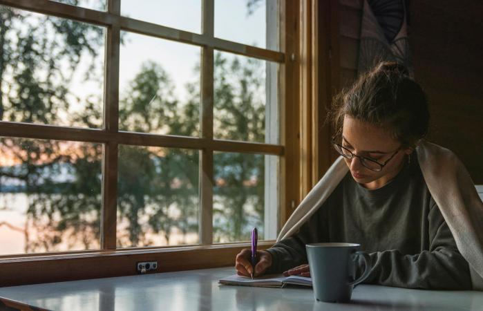 Woman writing into diary