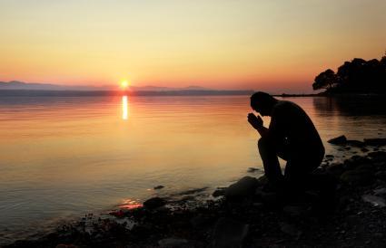A man meditating outside