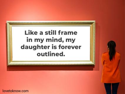 Woman looking at an empty frame on a red wall