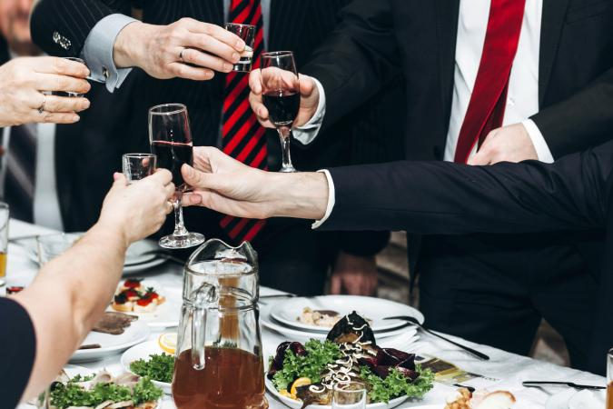 Man toasting at funeral reception
