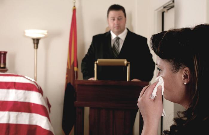 Man delivering eulogy speech