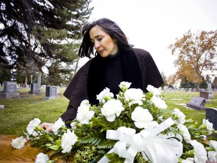 Woman at a funeral with flowers