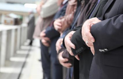 Muslim people at funeral pray