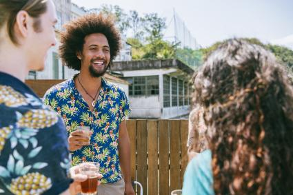 Man wearing Hawaiian Shirt celebration of life outdoor party