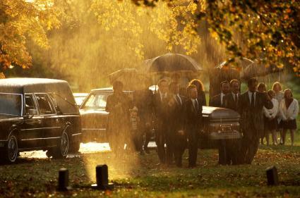 Funeral procession in the rain