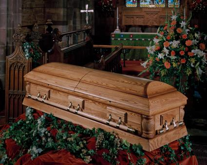 Catholic church funeral with coffin