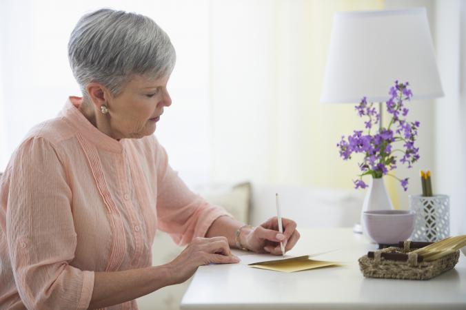 Woman writing sympathy card