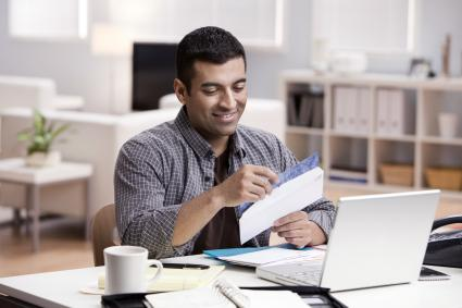 Man reading thank you note at the office