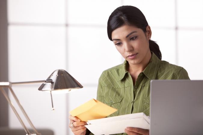 Woman at the office reading a card