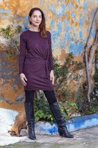 Woman wearing sweater dress and boots