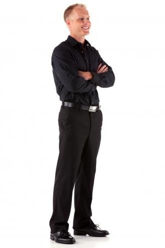 Man dressed in black with is arms crossed