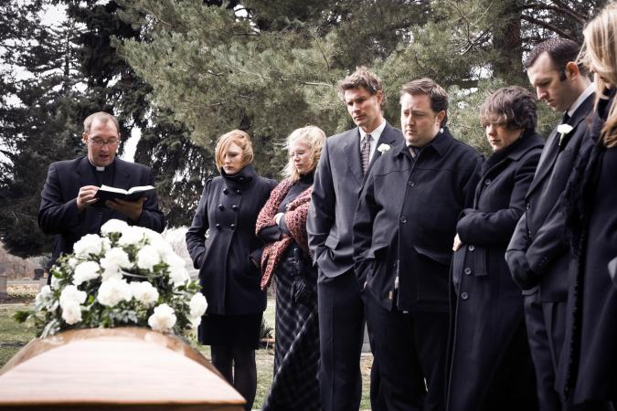 People at a winter funeral