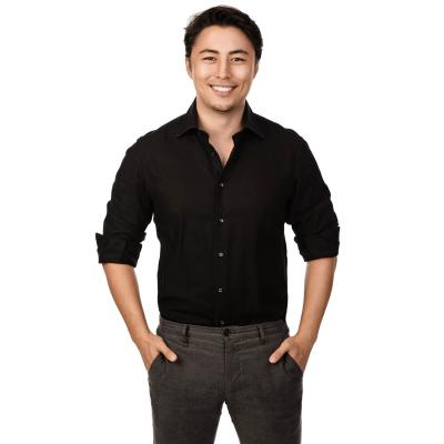 man in a black shirt and grey pants